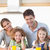 glimlachend · familie · ontbijt · keuken · huis · liefde - stockfoto © wavebreak_media