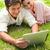 lächelnde · Frau · Freund · Tablet · zusammen · Gras - stock foto © wavebreak_media