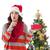 festive brunette keeping secret and holding gift stock photo © wavebreak_media