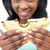 Pretty young woman eating a sandwich stock photo © wavebreak_media