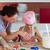 mulher · alimentação · bolinhos · feliz · fresco - foto stock © wavebreak_media
