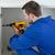 Handyman fixing a door in a kitchen stock photo © wavebreak_media