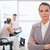 Consultant standing with folded arms and sitting customers behind her stock photo © wavebreak_media