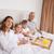 портрет · семьи · завтрак · спальня · глядя · камеры - Сток-фото © wavebreak_media