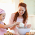 smiling mother and daughter preparing dough together stock photo © wavebreak_media