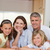 Happy smiling family behind kitchen table stock photo © wavebreak_media