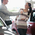 smiling woman receiving keys from a salesman in a car shop stock photo © wavebreak_media