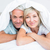 portrait of a mature couple lying in bed stock photo © wavebreak_media