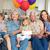 multigeneration family celebrating girls birthday stock photo © wavebreak_media