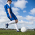 football player in blue kicking the ball on pitch stock photo © wavebreak_media