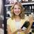 portrait of a smiling pretty blonde woman having a wine bottle stock photo © wavebreak_media