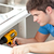 self assured man holding a drill repairing a kitchen sink stock photo © wavebreak_media