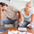 Worried couple calculating expenses in the living room stock photo © wavebreak_media