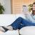 uśmiechnięty · młoda · kobieta · tabletka · sofa · komputera · Internetu - zdjęcia stock © wavebreak_media