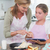 happy mother and daughter preparing cake together stock photo © wavebreak_media