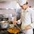 konsantre · kadın · pişirmek · mutfak · yandan · görünüş - stok fotoğraf © wavebreak_media