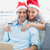 happy couple in santa hats shopping online with laptop stock photo © wavebreak_media