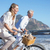 smiling couple riding their bikes on the beach stock photo © wavebreak_media