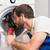 uomo · lavatrice · giovane · complessivo · casa - foto d'archivio © wavebreak_media