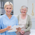 nurse holding clipboard while female patient sitting in clinic stock photo © wavebreak_media