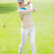 female golfer taking a shot and smiling at camera stock photo © wavebreak_media