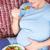 terhes · nő · eszik · saláta · otthon · nappali · ház - stock fotó © wavebreak_media