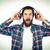 男 · 音楽を聴く · 音楽 · 技術 · 緑 · ヘッドホン - ストックフォト © wavebreak_media