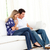 couple · salon · portable · souriant · femme · heureux - photo stock © wavebreak_media