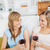 Happy two women drinking wine sitting on a sofa in the living-room stock photo © wavebreak_media