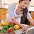 glimlachende · vrouw · met · behulp · van · laptop · groenten · computer · vrouw · voedsel - stockfoto © wavebreak_media