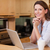 Smiling woman in the kitchen with her laptop stock photo © wavebreak_media