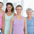 smiling women standing in yoga class stock photo © wavebreak_media