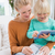 madre · hija · tableta · sofá · casa · salón - foto stock © wavebreak_media