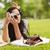 brunette lying on grass taking picture stock photo © wavebreak_media