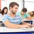 小さな · 学生 · ラップトップを使用して · 大学生 · 座って · 図書 - ストックフォト © wavebreak_media