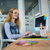 smiling designer sitting at her desk and typing on keyboard stock photo © wavebreak_media