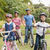 happy family on their bike at the park stock photo © wavebreak_media
