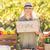 smiling blonde holding an organic signboard stock photo © wavebreak_media