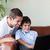 apa · fia · játszik · számítógép · kanapé · üzlet · gyermek - stock fotó © wavebreak_media