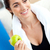 Smiling woman eating an apple on the sofa after working out in the living-room at home stock photo © wavebreak_media