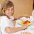 yandan · görünüş · mutlu · gülen · erkek · oturma · yemek · masası - stok fotoğraf © wavebreak_media