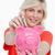 młoda · kobieta · zauważa · różowy · banku · piggy · biały · twarz - zdjęcia stock © wavebreak_media