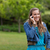 teenage girl standing in the countryside while using her mobile phone stock photo © wavebreak_media