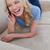 A young woman lying on a couch is talking on her mobile phone and laughing stock photo © wavebreak_media