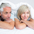 closeup of a mature couple lying in bed stock photo © wavebreak_media