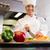 Smiling female chef cutting vegetables in kitchen stock photo © wavebreak_media