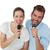 portrait of a cheerful couple singing into microphones stock photo © wavebreak_media