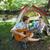 cute man serenading his girlfriend on camping trip stock photo © wavebreak_media