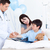 Charming doctor examining patient's arm at the hospital stock photo © wavebreak_media