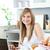 gülümseyen · kadın · kahvaltı · dizüstü · bilgisayar · bakıyor · kamera · mutfak - stok fotoğraf © wavebreak_media